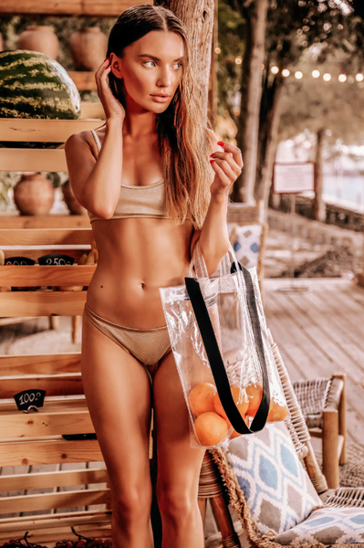 young woman with a bag of oranges