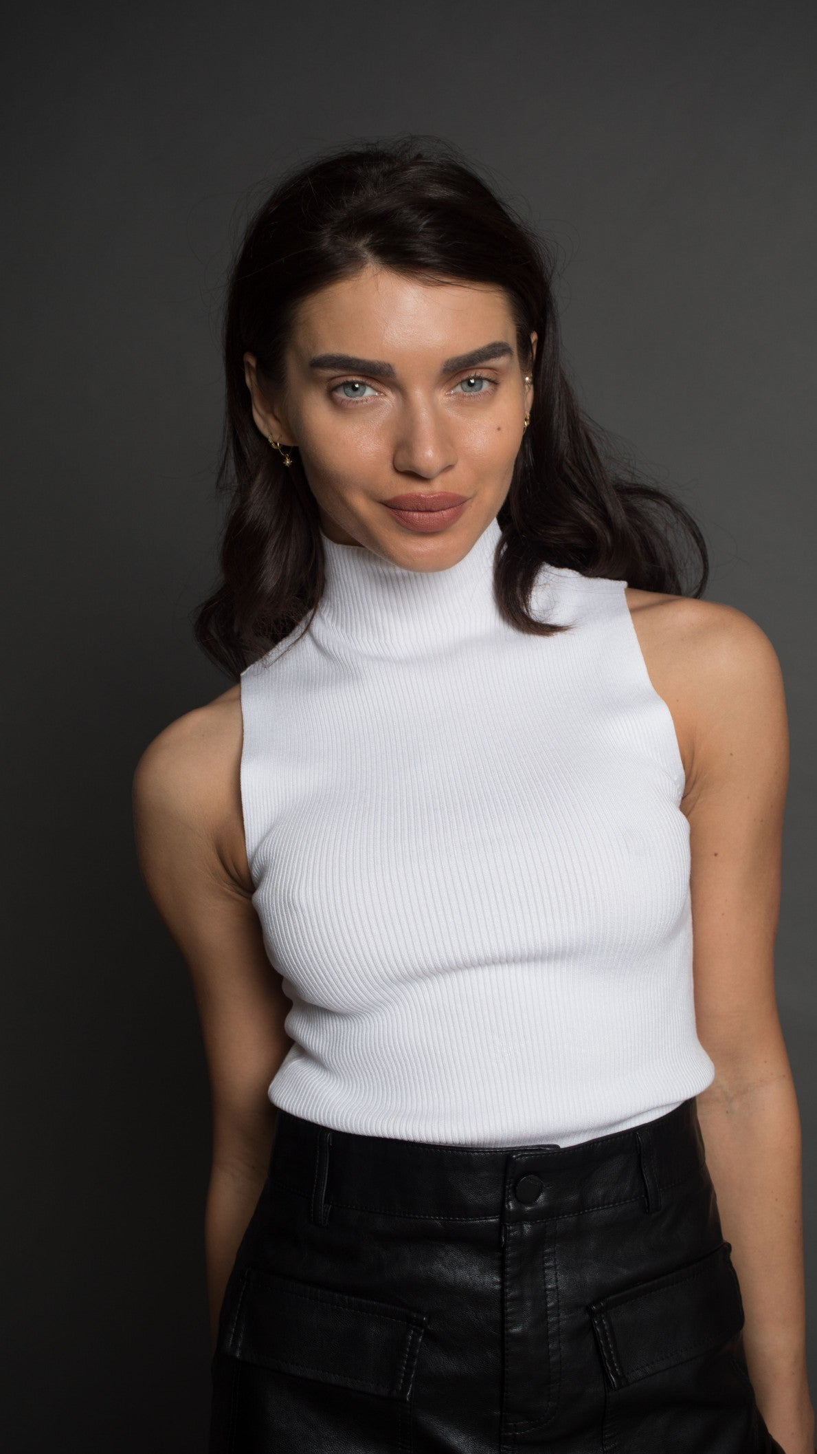 White sleeveless turtle neck