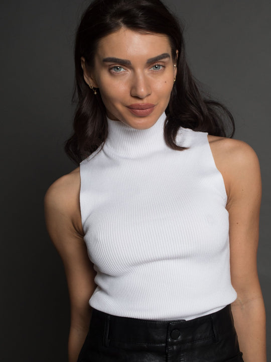 White sleeveless turtleneck