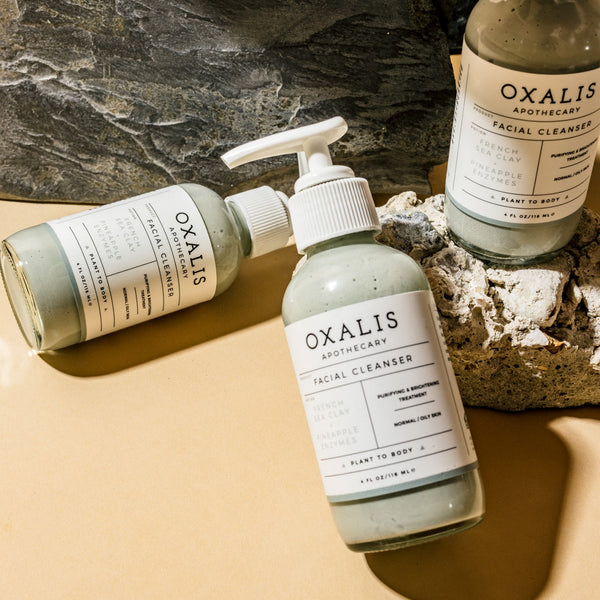 The Oxalis French Sea Clay + Pineapple Enzyme Cleanser. Flat Lay.