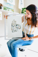 Artist displaying watercolor oyster painting