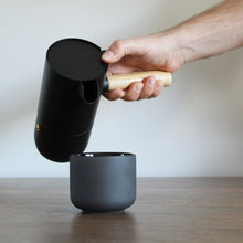 Load image into Gallery viewer, Stelton Collar Espresso Coffee Maker Pouring in cup