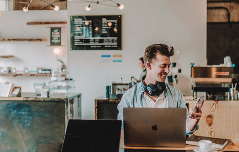 Man smiling in coffee shop