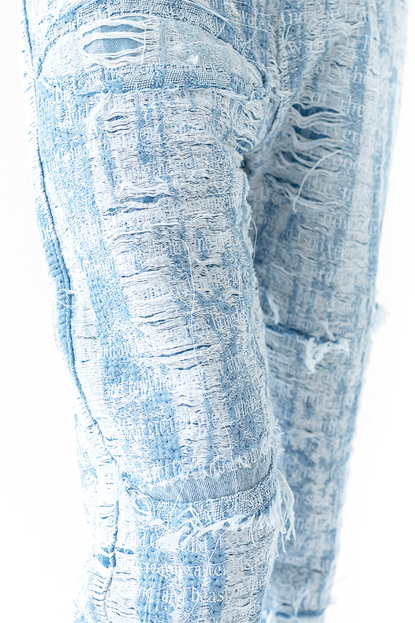 DISTRESSED STORM EMBROIDERED DENIM