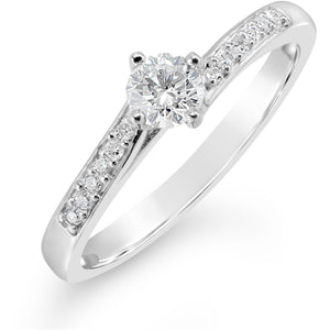 slight crossover diamond solitaire ring with stone set shoulders