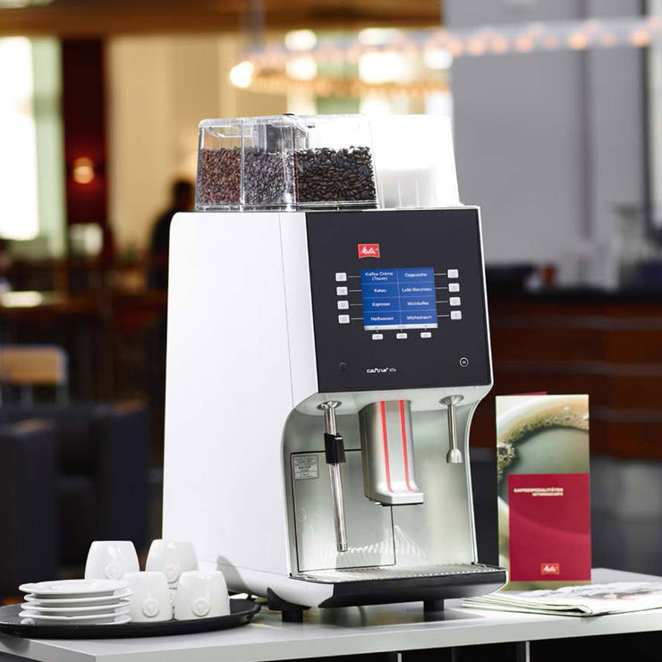 Melitta Cafina XT4 Bean To Cup Coffee Machine on a countertop at a hotel