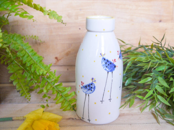 barney blue chicken milk bottle vase