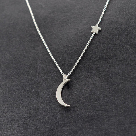 Subtle and delicate star and moon necklace