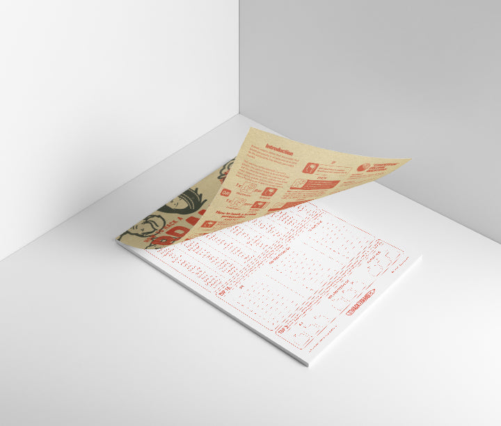 The how to hack a brand personality A4 notepad, with 50 sheets of workshop ready activities, opening to reveal the inner pages on a muted background resembling a corner of a room. The differentiating categories or red ink on white bond paper.
