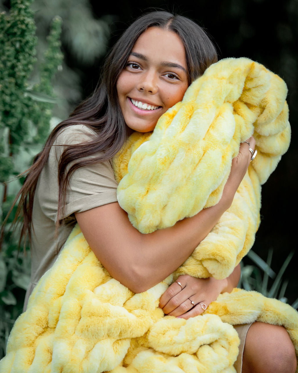Girl Snuggling with the lemon zest hugs blanket by Minky Couture.