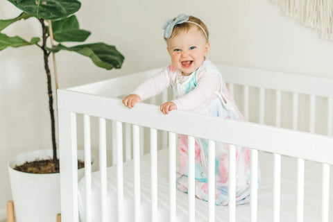 Little girl in a wearable minky couture blanket by Little Couture