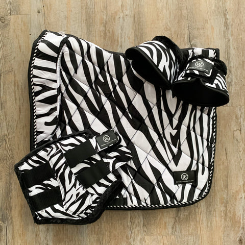 rebel equestrian zebra dressage set saddle pad bushing boots bell boots
