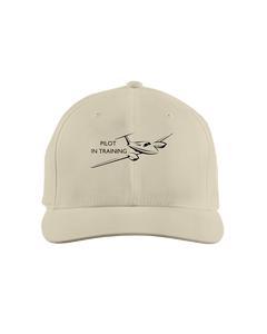 Pilot in training  single engine low wing black art on light cap