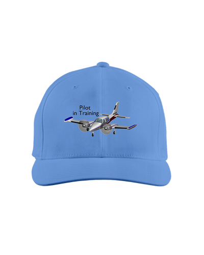 Pilot in training twin engine low wing dark art on white cap 1