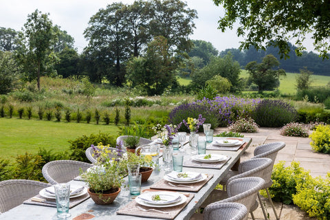 Outdoor dining area with elegant dining chairs