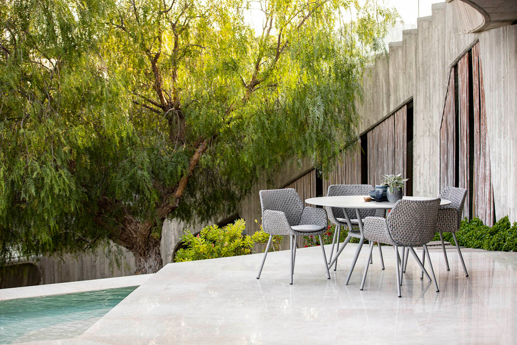 Modern outdoor dining chair with an elegant dining table