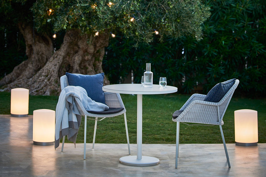 Small outdoor furniture with comfortable chairs and cafe table