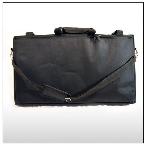 Case with shoulder strap and center handle