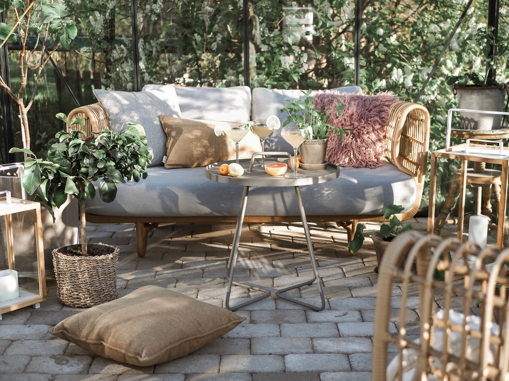 Greenhouse décor with outdoor weave lounge sofa