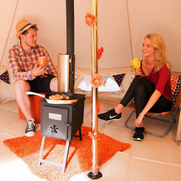 Couple enjoying Glawning luxury canvas bell tent driveaway awning