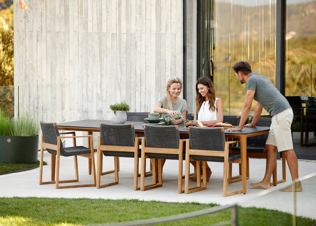 Exclusive outdoor dining table with teak dining chair