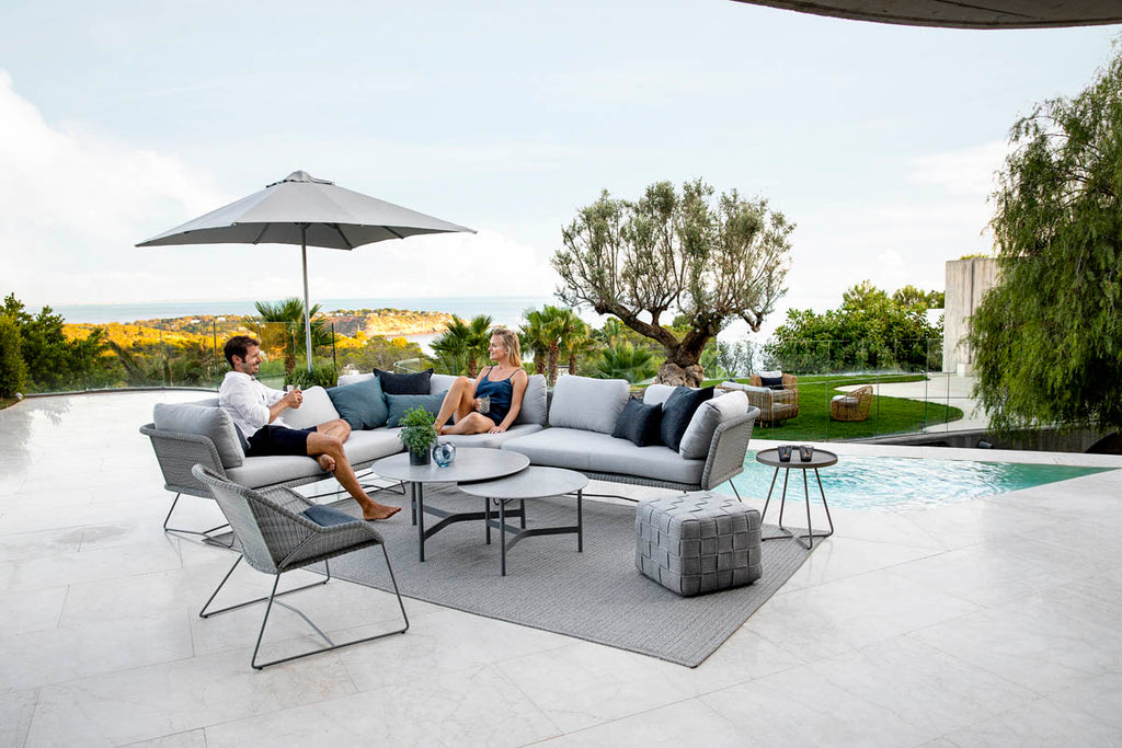 Modern lounge area with spacious and elegant outdoor lounge sofa and modern coffee tables