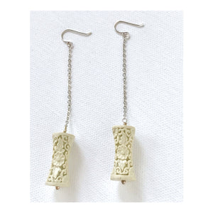 Carved White Resin and Silver Dangle Earrings