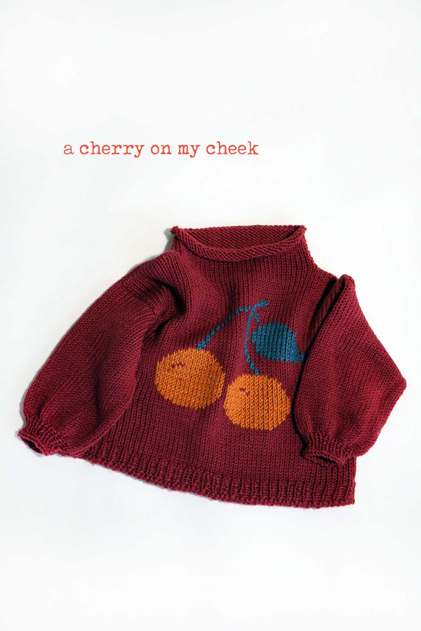 A cherry on may check sweater