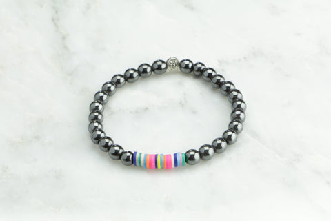 Hematite Bracelet beads with African Vinyl accent.