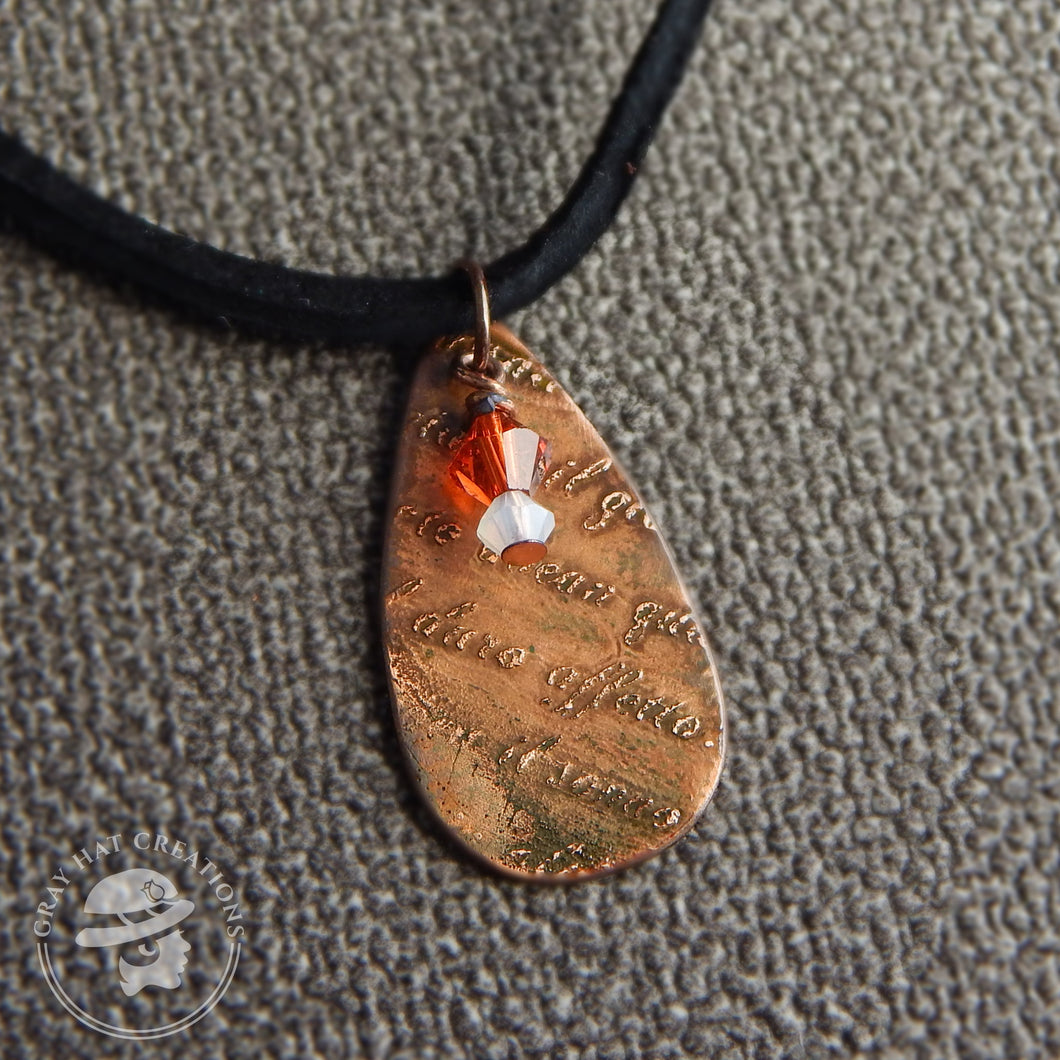 Copper script teardrop etched necklace with red and white crystals