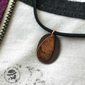 Copper etched teardrop with oval background