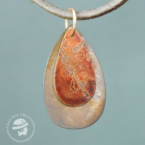 Copper etched teardrop with teardrop background