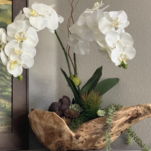 Beautifully unique + stylish, this free-form wood bowl with exceptionally realistic faux orchids will look amazing in your space + last forever.