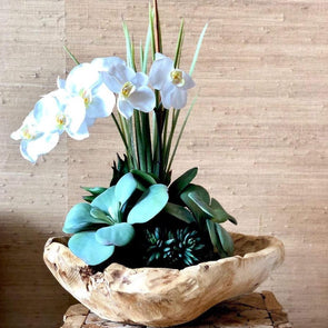 "Beautifully unique + stylish, this free-form wood bowl with exceptionally realistic faux orchids will look amazing in your space + last forever.  This Medium sized arrangement is approximately 12"" wide and 21"" high"