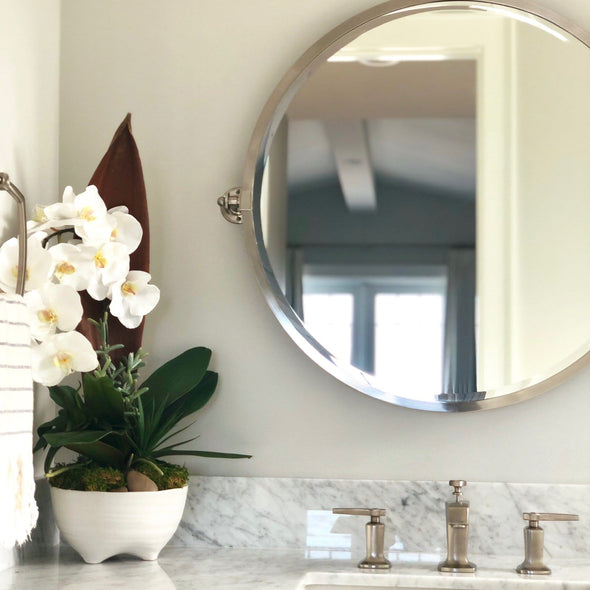 Luxury faux orchids paired with a preserved palm paddle in our modern footed planter. A stunning design that will compliment and elevate any space!  Local delivery only due to the nature of this design.
