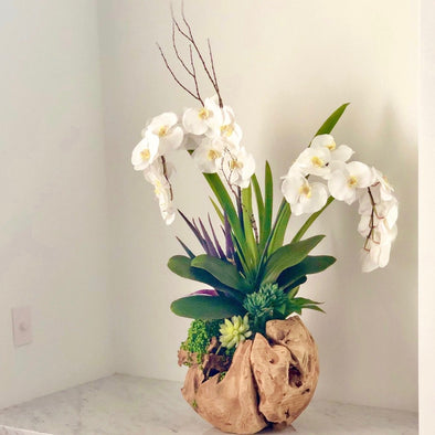 This reclaimed wood root bowl is a beautifully rustic + modern arrangement with faux white phalaenopsis orchids and hanging succulents; a perfect way to elevate any table.