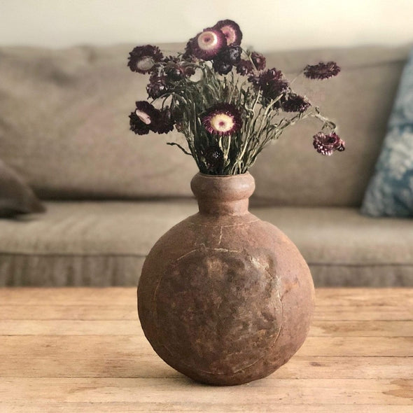 Vintage metal water vase, beautifully curved and aged with a patina finish that adds texture + warmth.