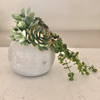 Modern, round bubble cement vase filled with premium faux succulents - no water needed! It's lightweight, modern yet warm styling is perfect for your desk, shelf or small table. Our high quality faux greenery is deceptively real looking and will fool even the most discerning eye.