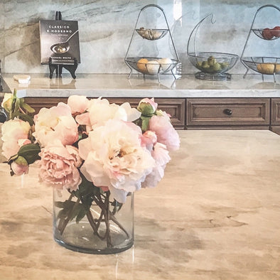 Peonies + Roses are everyone's favorite flowers, and now you can have them all year round. Beautifully clean + classic, this arrangement is placed in a sturdy modern glass vase that will add elegance to any surface.