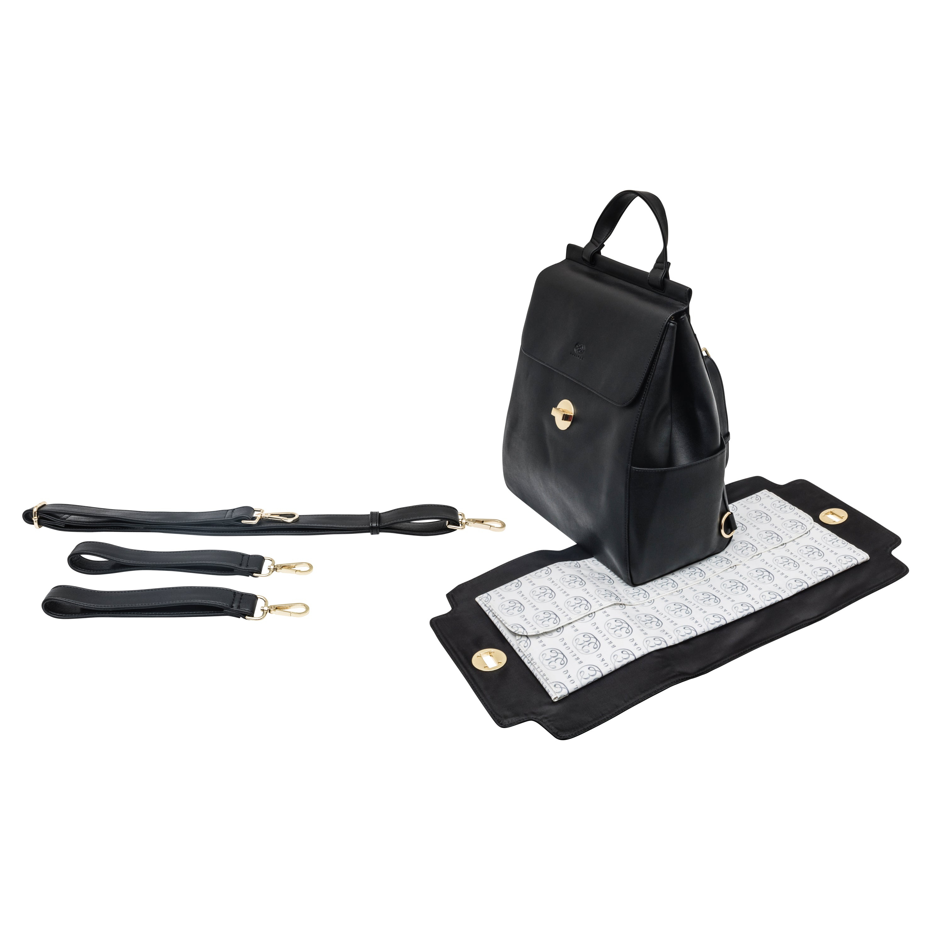 fashion diaper bag with a changing station installed on the exterior and that is completely detachable