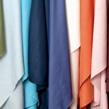 Apparel fabrics image showing a variety of colors