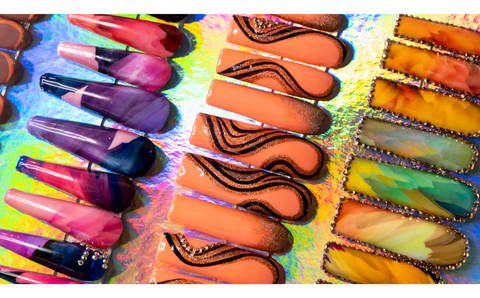 Badass Creative Nails by www.TheGlamSquad.co.uk Orange swirl nails in Extreme lengths Square