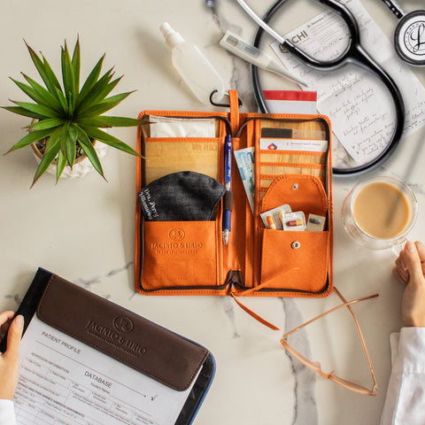 A wallet storing different essential objects for a doctor on top of a table