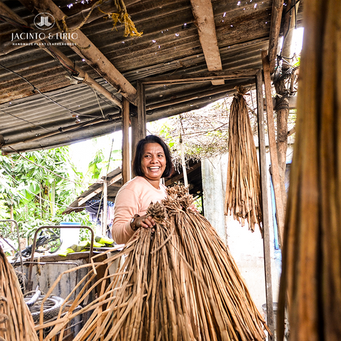 Woman holding water Hyacinth stalks