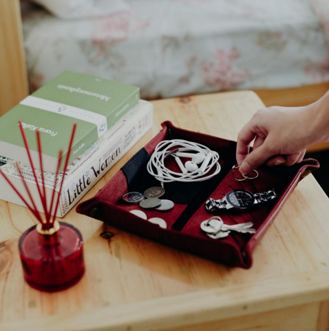 A on the go storage pouch lay out on the table storing different materials at home such as watches, earphones, coins and more