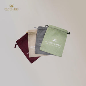 Linen Drawstring Eco-Bag made with water hyacinth vegan leather with Jacinto and Lirio Logo Printed spread out showing the different colors available