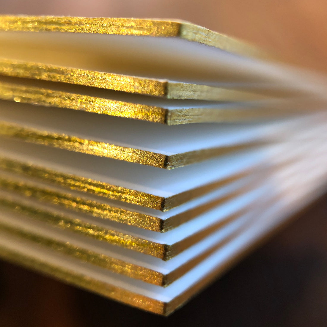 Detail photo of gilded edge treatment