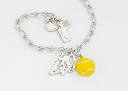 Gina is wearing her passion of tennis and the ocean close to her heart.