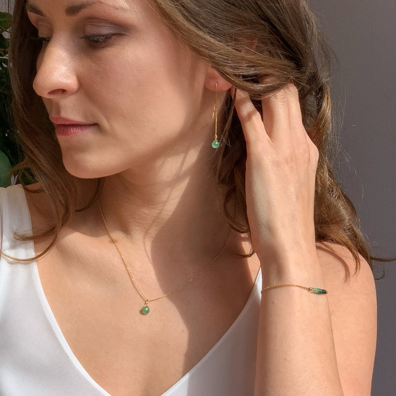 Zambian emerald necklace and earrings in Gold