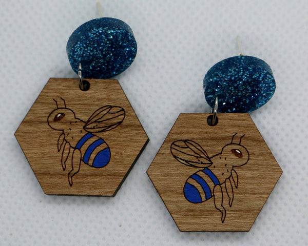 Belle the blue-banded bee dangles